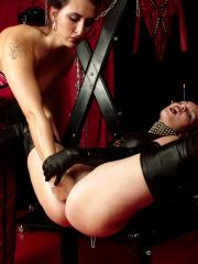 Latex mistress whips crops and dildos her slavegirl
