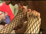 Feet in fishnet stockings