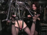 Mistress dominates sissy in bondage