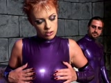 Couple in purple latex have sex